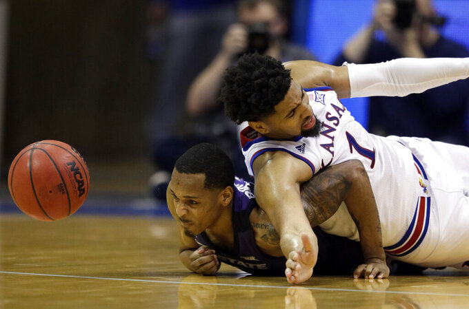 Kansas State guard Barry Brown Jr., left, and Kansas forward Dedric Lawson (1) dive for the ball during the second half of an NCAA college basketball game in Lawrence, Kan., Monday, Feb. 25, 2019. (AP Photo/Orlin Wagner)