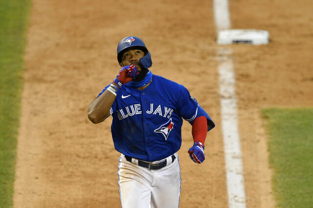 Toronto Blue Jays' Teoscar Hernandez reacts as he heads home on his home run during the eighth inning of a baseball game against the Washington Nationals, Thursday, July 30, 2020, in Washington. The Nationals won 6-4.(AP Photo/Nick Wass)