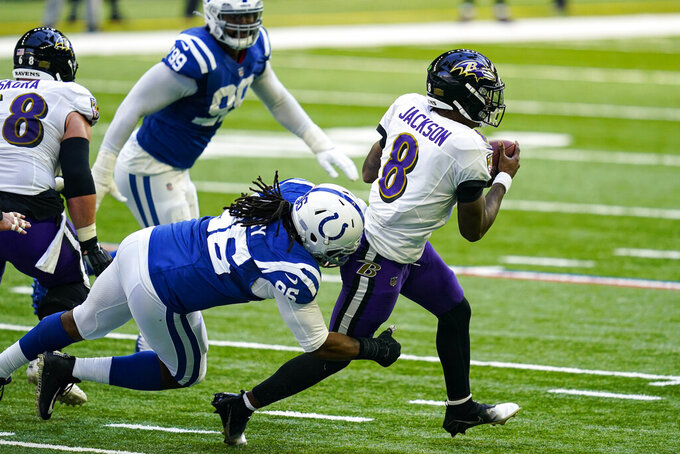Indianapolis Colts defensive tackle Denico Autry (96) sacks Baltimore Ravens quarterback Lamar Jackson (8)] in the first half of an NFL football game in Indianapolis, Sunday, Nov. 8, 2020. (AP Photo/Darron Cummings)