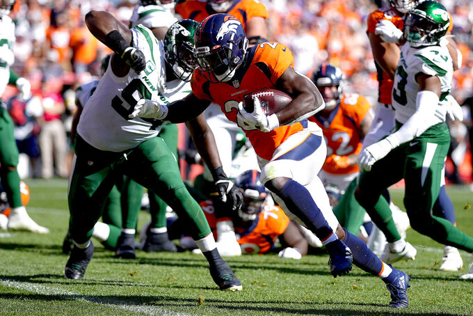 Denver Broncos running back Melvin Gordon (25) runs in for a touchdown as New York Jets defensive tackle Foley Fatukasi (94) defends during the first half of an NFL football game, Sunday, Sept. 26, 2021, in Denver. (AP Photo/Jack Dempsey)