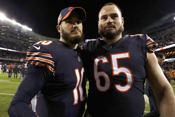 Chicago Bears quarterback Mitchell Trubisky (10) and center Cody Whitehair (65) walk off the field after an NFL wild-card playoff football game against the Philadelphia Eagles Sunday, Jan. 6, 2019, in Chicago. The Eagles won 16-15. (AP Photo/Nam Y. Huh)