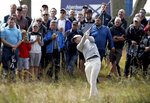 Denmark's Lucas Bjerregaard hits out of the rough on the 1st hole during the Scottish Open golf tournament at The Renaissance Club, in North Berwick, Scotland, Friday July 12, 2019. (Jane Barlow/PA via AP)