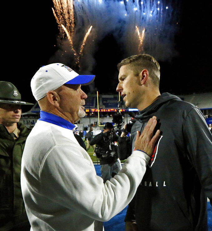 Middle Tennessee coach Rick Stockstill, left, talks with Western Kentucky coach Mike Sanford after an NCAA college football game Friday, Nov. 2, 2018, in Murfreesboro, Tenn. Middle Tennessee won 29-10. (AP Photo/Mark Humphrey)