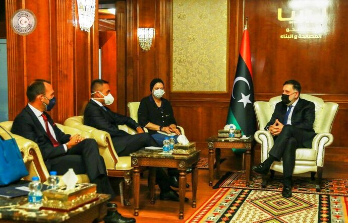 Libya's internationally recognized Prime Minister Fayez al-Sarraj, right, meets with Italian Foreign Minister Luigi Di Maio, second from the left, in Tripoli, Libya Tuesday, Sept. 1, 2020. (Libyan Government via AP)