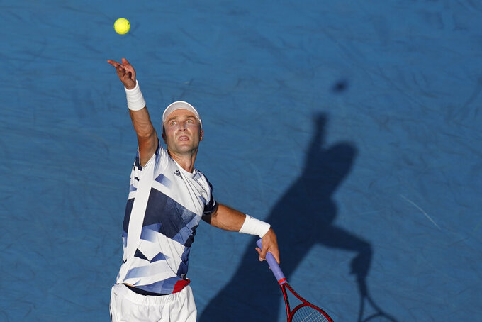 Liam Broady, of Britain, serves to Hubert Hurkacz, of Poland, during the second round of the men's tennis competition at the 2020 Summer Olympics, Tuesday, July 27, 2021, in Tokyo, Japan. (AP Photo/Patrick Semansky)