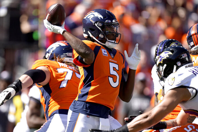 Denver Broncos quarterback Teddy Bridgewater (5) throws against the Baltimore Ravens during the first half of an NFL football game, Sunday, Oct. 3, 2021, in Denver. (AP Photo/David Zalubowski)