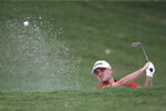 Austin Cook of the United States of America hits off the bunker during round one of the CIMB Classic golf tournament at Tournament Players Club (TPC) in Kuala Lumpur, Malaysia, Thursday, Oct. 11, 2018. (AP Photo/Vincent Phoon)