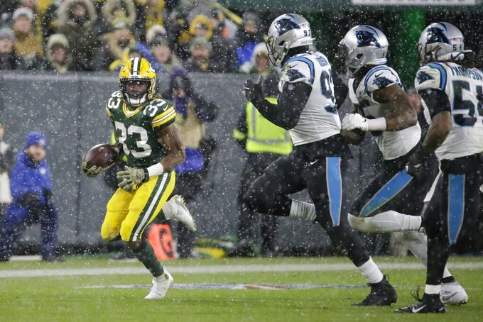 Green Bay Packers' Aaron Jones runs during the second half of an NFL football game against the Carolina Panthers Sunday, Nov. 10, 2019, in Green Bay, Wis. (AP Photo/Mike Roemer)