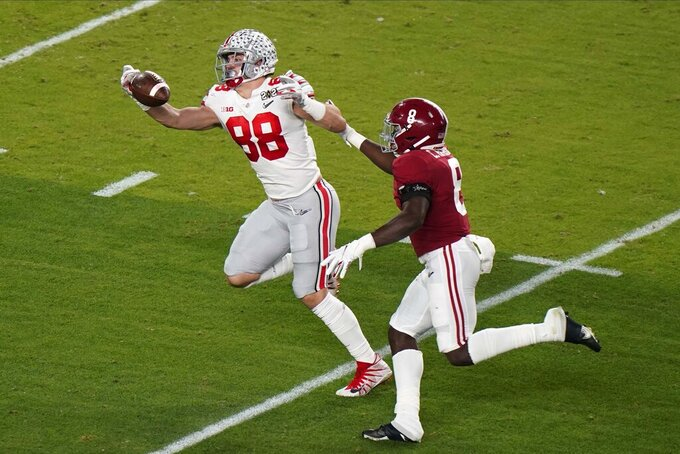 Ohio State tight end Jeremy Ruckert catches a pass in front of Alabama linebacker Christian Harris during the first half of an NCAA College Football Playoff national championship game, Monday, Jan. 11, 2021, in Miami Gardens, Fla. (AP Photo/Wilfredo Lee)