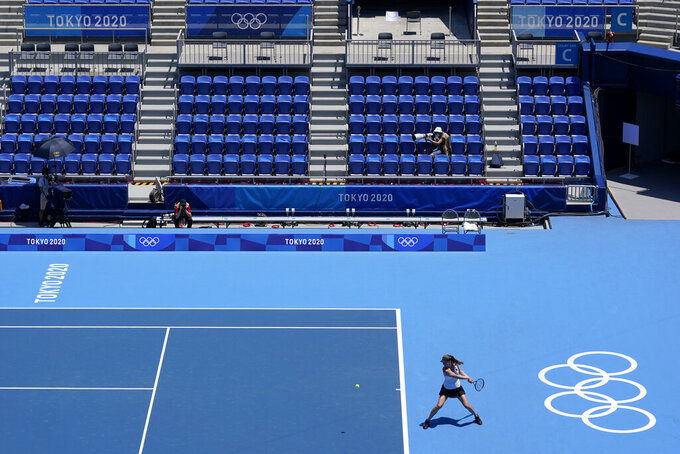 Mona Barthel, of Germany, returns to Iga Swiatek, of Poland, during the tennis competition at the 2020 Summer Olympics, Saturday, July 24, 2021, in Tokyo, Japan. (AP Photo/Patrick Semansky)