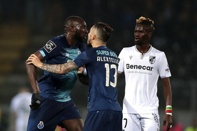 Porto's Moussa Marega, from Mali, left, leaves the pitch during a Portuguese league soccer match between Vitoria SC and FC Porto in Guimaraes, Portugal, Sunday, Feb. 15, 2020. The president and the prime minister of Portugal have added their voices to a national outcry over racist abuse aimed at Moussa Marega who walked off the field after hearing monkey chants. (AP Photo)