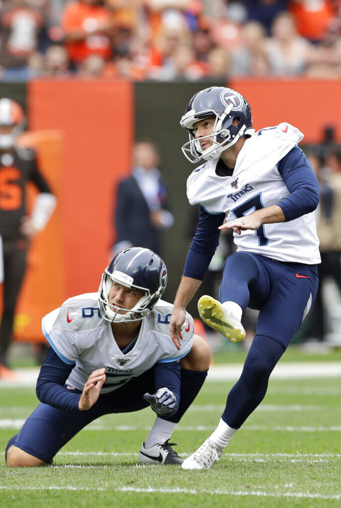 Tennessee Titans kicker Cairo Santos watches his ball after kicking a 53-yard field goal during the second half in an NFL football game against the Cleveland Browns, Sunday, Sept. 8, 2019, in Cleveland. (AP Photo/Ron Schwane)