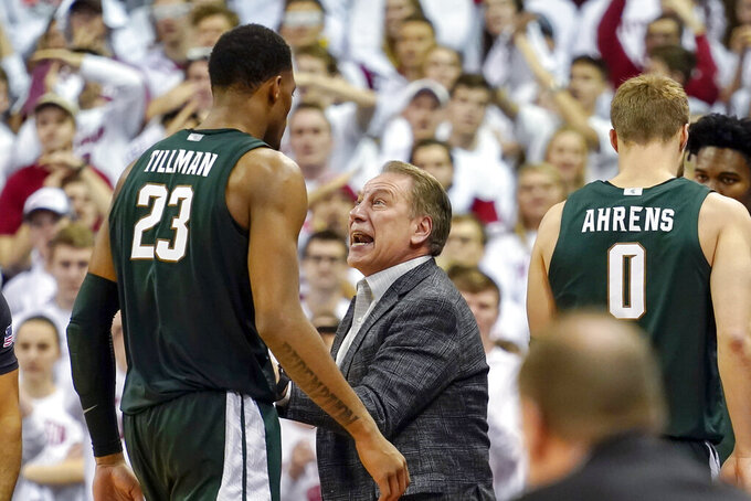Michigan State head coach Tom Izzo talks with Xavier Tillman (23) during the second half of an NCAA college basketball game against Wisconsin, Saturday, Feb. 1, 2020, in Madison, Wis. Wisconsin upset Michigan State 64-63. (AP Photo/Andy Manis)