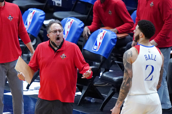 New Orleans Pelicans head coach Stan Van Gundy, left, reacts during overtime of an NBA basketball game against the Boston Celtics in New Orleans, Sunday, Feb. 21, 2021. (AP Photo/Gerald Herbert)