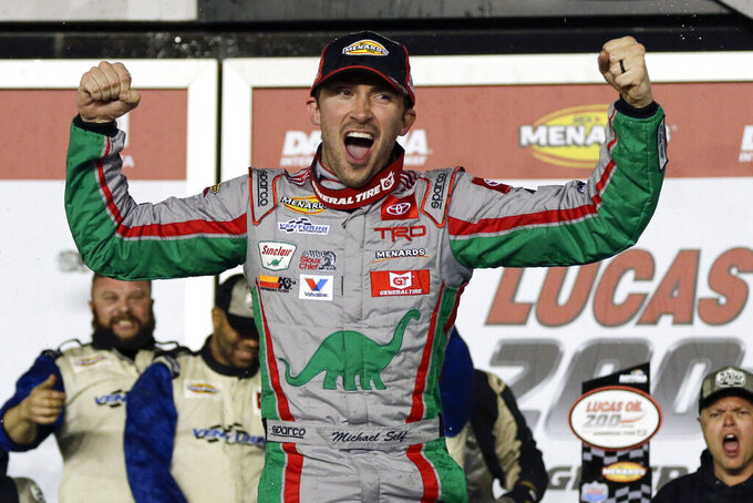 Michael Self celebrates in Victory Lane after winning the ARCA auto race at Daytona International Speedway, Saturday, Feb. 8, 2020, in Daytona Beach, Fla. (AP Photo/Terry Renna)
