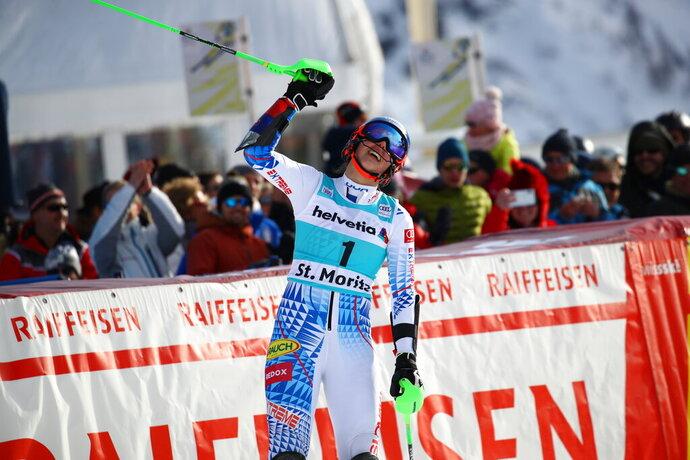Slovakia's Petra Vlhova celebrates at the finish area of an alpine ski, women's parallel slalom World Cup in St. Moritz, Switzerland, Sunday, Dec. 15, 2019. (AP Photo/Sergio Bisi)
