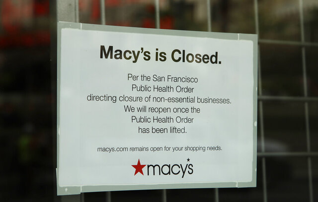 A closed sign is displayed on a Macy's storefront window Monday, March 30, 2020, in San Francisco. Macy's announced that they would furlough a majority of their 130,000 workers after their stores closed due to the virus outbreak. (AP Photo/Ben Margot)