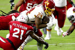 Washington Football Team running back Antonio Gibson (24) scores a touchdown as Arizona Cardinals cornerback Patrick Peterson (21) defends during the second half of an NFL football game, Sunday, Sept. 20, 2020, in Glendale, Ariz. (AP Photo/Darryl Webb)