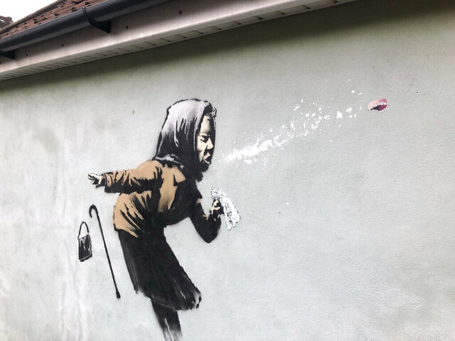 "Banksy's latest mural titled ""Aachoo!!"" that has appeared on a wall in Bristol, England, Thursday Dec. 10, 2020. Banksy's latest mural has delayed - but not thwarted - a homeowner's plans to sell in Bristol after it recently appeared on the house's exterior wall. (Claire Hayhurst/PA via AP)"