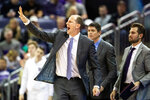 Washington head coach Mike Hopkins gives instructions to his team during the first half of an NCAA college basketball game against Seattle, Tuesday, Dec. 17, 2019, in Seattle. (Andy Bao/The Seattle Times via AP)