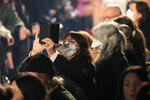 FILE - In this Feb. 27, 2020 file photo, spectators wear protective masks during the Isabel Marant fashion collection during Women's fashion week Fall/Winter 2020/21 presented in Paris. The coronavirus pandemic has instilled extra unpredictability into the already fickle Paris Fashion Week. After first canceling the July shows for menswear and Haute Couture, the French fashion federation has now organized an unprecedented schedule of digital-only events instead. (AP Photo/Michel Euler, File)