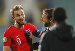 England manager Gareth Southgate, right, shares a laugh with England's Harry Kane at the end of the Euro 2020 group A qualifying soccer match between Bulgaria and England, at the Vasil Levski national stadium, in Sofia, Bulgaria, Monday, Oct. 14, 2019. (AP Photo/Vadim Ghirda)