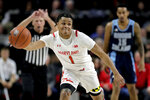 Maryland guard Anthony Cowan Jr. chases the ball during the first half of an NCAA college basketball game against Rhode Island, Saturday, Nov. 9, 2019, in College Park, Md. (AP Photo/Julio Cortez)