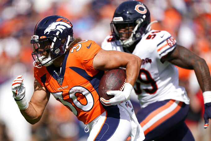 Denver Broncos running back Phillip Lindsay (30) runs as Chicago Bears inside linebacker Danny Trevathan (59) pursues during the first half of an NFL football game, Sunday, Sept. 15, 2019, in Denver. (AP Photo/Jack Dempsey)