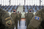 Kosovo Security Force (KSF) members wearing protective face masks line up, during a peacekeeping mission deployment ceremony held at the army barracks in Pristina, Tuesday, March 9, 2021. Kosovo is sending a military platoon to Kuwait, its first ever involvement in an international peacekeeping mission. A ceremony was held Tuesday at the army barracks in the capital, Pristina, with the presence of top country leaders and western military attaches. Kosovo is sending the military unit following a request from the U.S. Central Command. (AP Photo/Visar Kryeziu)