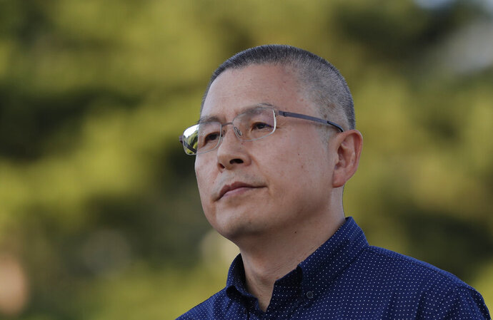 Hwang Kyo-ahn, the main opposition Liberty Korea Party chairman, stands after shaved head in Seoul, South Korea, Monday, Sept. 16, 2019. The leader of South Korea's biggest opposition party has become the latest politician to shave their heads to protest President Moon Jae-in's appointment of a key political ally as justice minister despite allegations of academic fraud and financial crimes surrounding his family. (AP Photo/Lee Jin-man)