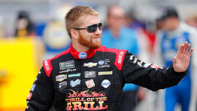 Chris Buescher walks to his car before qualifying for the NASCAR cup series race at Michigan International Speedway, Saturday, June 8, 2019, in Brooklyn, Mich. (AP Photo/Carlos Osorio)