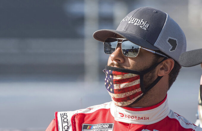 Bubba Wallace (43) looks on in the pit area before a NASCAR Cup Series auto race at Martinsville Speedway in Martinsville, Va., Sunday, Nov.1, 2020. (AP Photo/Lee Luther Jr.)