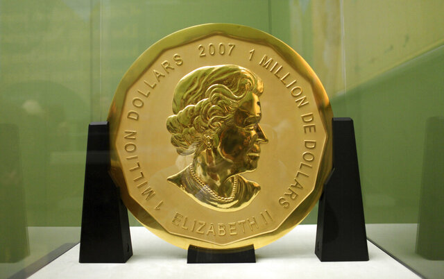 FILE -- In this Dec. 8, 2010 photo a 100-kilogram (221-pound) Canadian gold coin is displayed at the Bode Museum in Berlin, Germany. German prosecutors are seeking lengthy prison terms for four men accused of staging the brazen theft of a Canadian gold coin that disappeared from a Berlin museum almost three years ago. The 'Big Maple Leaf' coin, worth several million dollars, was stolen from the Bode Museum in March 2017. (Marcel Mettelsiefen/dpa via AP, file)