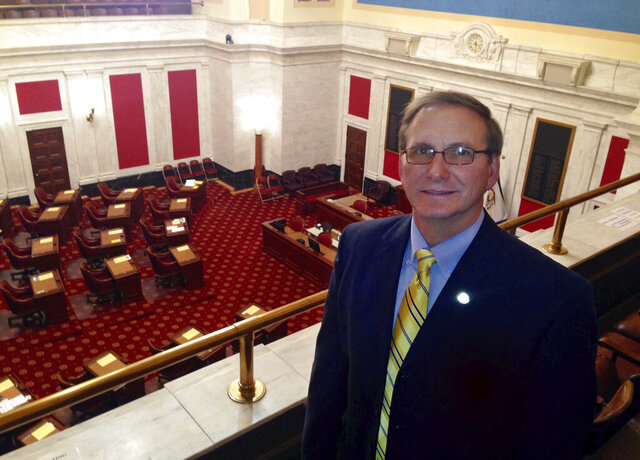 FILE - This Tuesday Feb. 10, 2015, file photo shows Dr. Ron Stollings, a West Virginia state senator, as he stands in the gallery of the state Senate chambers, at the Capitol in Charleston, W.Va. Stollings is participating in a Democratic debate in Bridgeport on Tuesday, May 19, 2020. (AP Photo/John Raby)