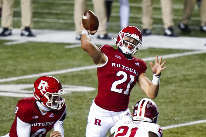Rutgers quarterback Johnny Langan (21) throws a pass in the third quarter of an NCAA college football game against Indiana, Saturday, Oct. 31, 2020, in Piscataway, N.J. (AP Photo/Corey Sipkin)