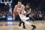 Boston Celtics guard Marcus Smart, right, fouls New York Knicks forward Kevin Knox (20) during the first half of an NBA basketball game Friday, Feb. 1, 2019, at Madison Square Garden in New York. (AP Photo/Mary Altaffer)