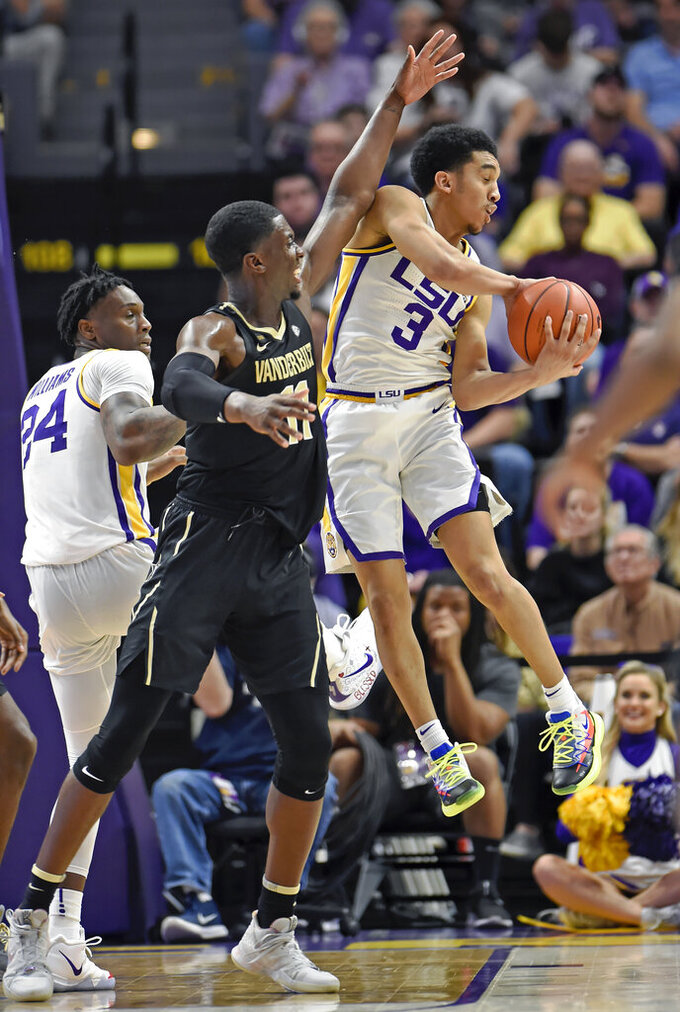 LSU guard Tremont Waters (3) looks to make the outlet pass as Vanderbilt center Simisola Shittu (11) defends in the first half of an NCAA college basketball game, Saturday, March 9, 2019, in Baton Rouge, La. (AP Photo/Bill Feig)