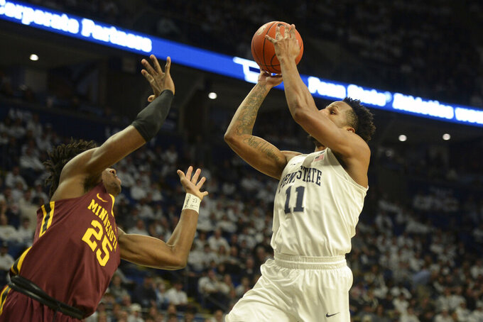 Penn State's Lamar Stevens (11) drives to the basket with Minnesota's Daniel Oturu (25) attempting to block his shot during first-half action of an NCAA college basketball game, Saturday, Feb. 8, 2020, in State College, Pa. (AP Photo/Gary M. Baranec)