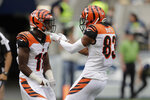 Cincinnati Bengals wide receiver John Ross, left, celebrates with wide receiver Tyler Boyd after catching a pass for a touchdown against the Seattle Seahawks during the first half of an NFL football game, Sunday, Sept. 8, 2019, in Seattle.(AP Photo/Stephen Brashear)