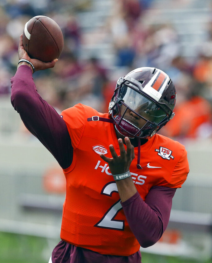 Virginia Tech quarterback Hendon Hooker warms up for the NCAA college football team's Maroon-White spring game in Blacksburg, Va., Saturday, April 13, 2019. (Matt Gentry/The Roanoke Times via AP)