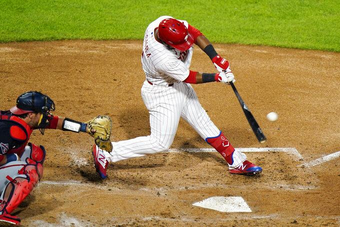 Philadelphia Phillies' Jean Segura hits a three-run double off Washington Nationals pitcher Erick Fedde during the fourth inning of a baseball game, Monday, Aug. 31, 2020, in Philadelphia. (AP Photo/Matt Slocum)