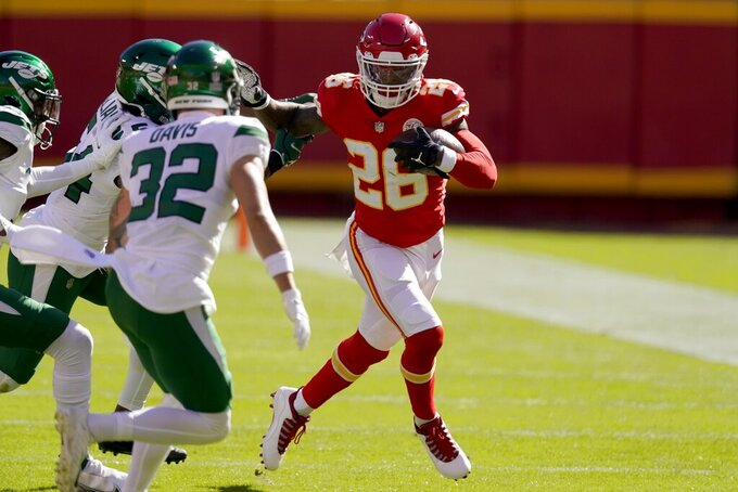 New York Jets safety Ashtyn Davis (32) and others attempt to stop Kansas City Chiefs running back Le'Veon Bell (26) in the first half of an NFL football game on Sunday, Nov. 1, 2020, in Kansas City, Mo. (AP Photo/Charlie Riedel)