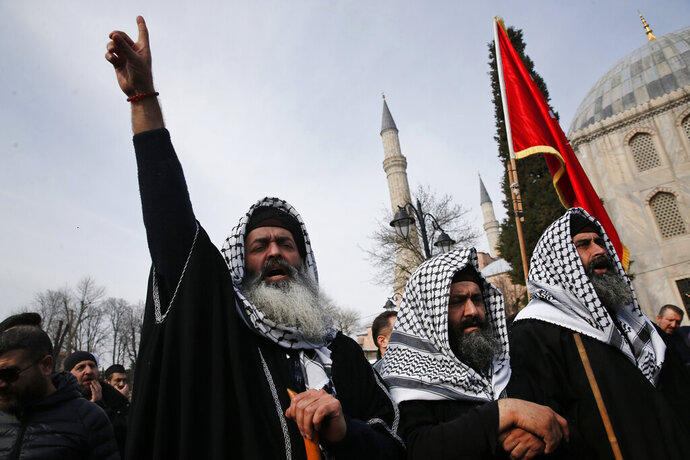Backdropped by the Byzantine-era Hagia Sophia, demonstrators chant slogans against the mosque attacks in New Zealand during a protest in Istanbul, Saturday, March 16, 2019. World leaders expressed condolences and condemnation following the deadly attacks on mosques in the New Zealand city of Christchurch, while Muslim leaders said the mass shooting was evidence of a rising tide of violent anti-Islam sentiment.(AP Photo/Lefteris Pitarakis)