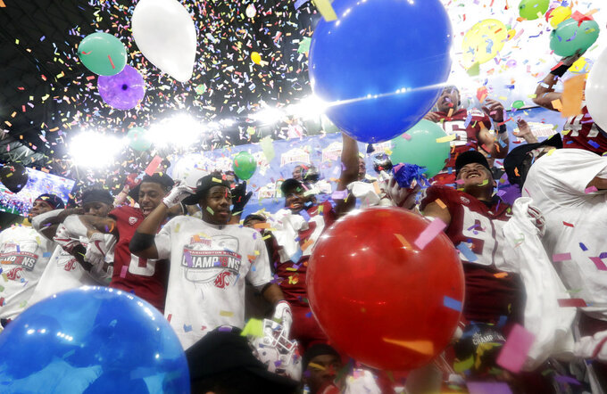 Washington State players celebrate their 28-26 win over Iowa State in the Alamo Bowl NCAA college football game Friday, Dec. 28, 2018, in San Antonio. (AP Photo/Eric Gay)