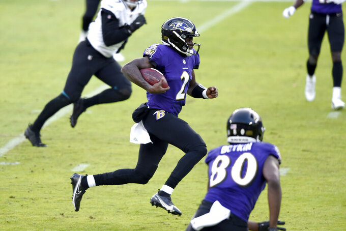 Baltimore Ravens quarterback Tyler Huntley (2) runs with the ball against the Jacksonville Jaguars during the second half of an NFL football game, Sunday, Dec. 20, 2020, in Baltimore. The Ravens won 40-14. (AP Photo/Gail Burton)