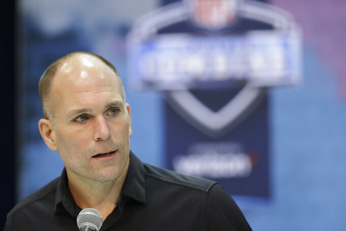 FILE - In this Feb. 27, 2019, file photo, Baltimore Ravens general manager Eric DeCosta speaks during a news conference at the NFL football scouting combine in Indianapolis. For the first time in Ravens history, someone other than Ozzie Newsome will be in charge of the NFL draft. After working his way up the team's corporate ladder, former intern DeCosta in January succeeded Newsome as the team's general manager. (AP Photo/Darron Cummings, File)