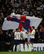 England's Harry Kane, center, celebrates with his teammates after scoring his side's third goal during the Euro 2020 group A qualifying soccer match between England and Montenegro at Wembley stadium in London, Thursday, Nov. 14, 2019. (AP Photo/Ian Walton)