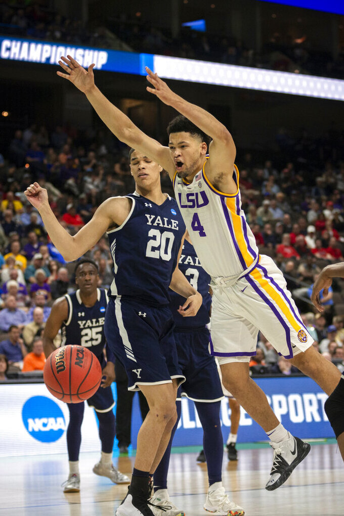 LSU guard Skylar Mays (4) is stripped of the ball from Yale forward Paul Atkinson (20) during the second half of the first round men's college basketball game in the NCAA Tournament in Jacksonville, Fla., Thursday, March 21, 2019. (AP Photo/Stephen B. Morton)