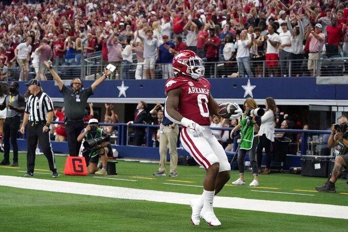 Arkansas running back AJ Green scores a touchdown on a long run in the first half of an NCAA college football game against Texas A&M in Arlington, Texas, Saturday, Sept. 25, 2021. (AP Photo/Tony Gutierrez)