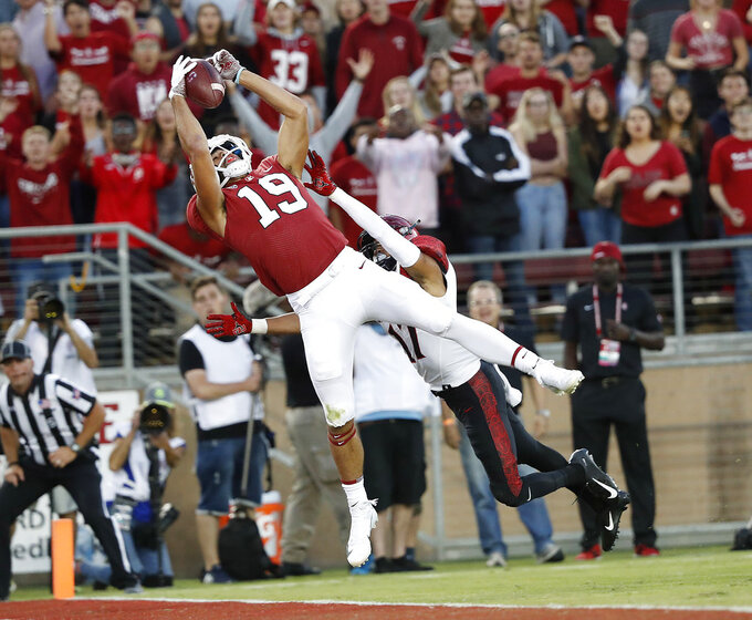Stanford wide receiver JJ Arcega-Whiteside (19) catches a touchdown pass against San Diego State cornerback Ron Smith (17) during the first half of an NCAA college football game Friday, Aug. 31, 2018, in Stanford, Calif. (AP Photo/Tony Avelar)